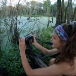 Girl taking photo of nature